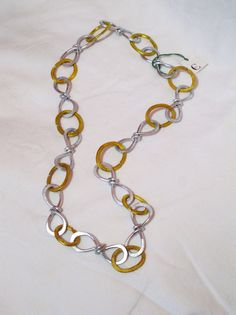 necklace in gold and silver hammered aluminum by giovannacargnelli, €28.00