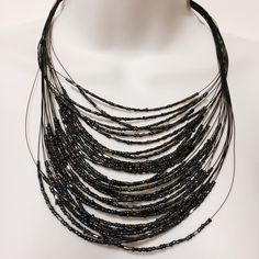"Multiple Strand Jet Seed Bead Necklace Jet beauty! This lovely black multiple strand seed bead necklace reflects light as you move. The opulence beads brings shaded of blues, greens and fuchsia to this design. 20"" with 3"" extender. Silver tone lobster claw closure.Fashion jewelry Jewelry Necklaces"