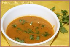 Gujarati Dal is cooked lentil soup with lots of spices, jeggery and lemon or tamarind. It always contains herbs and spices such as coriander, cumin, turmeric ..... This is a great tasting daal and is very healthy and very popular in south part of Gujarat.