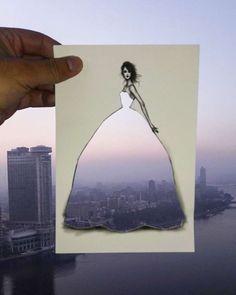 Este ilustrador de moda completa sus elegantes vestidos con paisajes naturales nubes y edificios