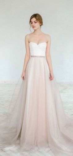 Blush beauty #WeddingDress repinned by wedding accessories and gifts specialists...