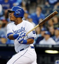 Kansas City Royals' Salvador Perez (13) hits a double during the first inning of a baseball game against the Minnesota Twins at Kauffman Stadium in Kansas City, Mo., Tuesday, April 9, 2013. Perez drove in teammate Billy Butler with the hit. (AP Photo/Orlin Wagner)