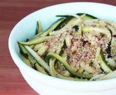 """When you're craving a big bowl of garlicky pasta, cook up these zucchini noodles aglio et olio (garlic and oil) instead. The real comfort here, other than that fragrant garlic, comes from """"breadcrumbs"""" created from toasted almond meal. Total Calories: 257  Photo: Lizzie Fuhr"""