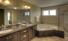 What a great place to unwind! We <3 this Blakely's spacious master bathroom and giant tub!