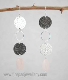 """Sterling silver and rose quartz.  Just over 3"""", these earrings are dramatic and subtle all at the same time!"""