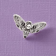 Black death head moth hard enamel gemstone pin, with butterfly clutch on the reverse. Teeny enough to adorn your bag, lapel, pocket or whatever you fancy. Hand designed here in the UK, and manufactured in exclusive low quantities. This pin measures 25mm wide , and is made from lovely smooth enamel for a hard wearing finish. Now also available in gunmetal black finish as well as the usual silver:)