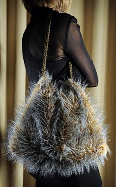 Faux feather fur made into a tote....use chain for a strap.
