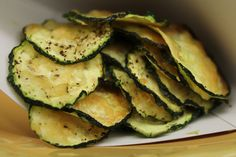 Parmesan Zucchini Chips Ingredients 4 zucchini 1 tsp salt 1 tsp pepper 1/2 tsp cayenne pepper 1 tsp garlic powder 1/4 cup Parmesan Directions Preheat your oven to 350 degrees. Keep the skin on your zucchini and cut each one very thin…like chips. You can cut them yourself, but using a mandolin saves so much …