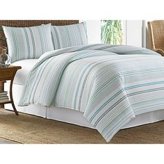 Tommy Bahama's Seaglass La Scala Duvet cover features a cabana stripe in cool ocean blues and greens on an ivory ground. Set includes duvet cover with button closure and 2 shams.
