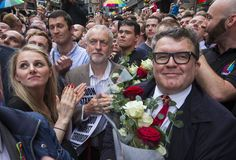 Jeremy Corbyn and Tom Watson lay flowers at the Old Compton Street vigil