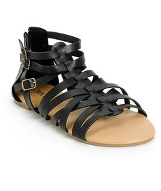 Step up your style with these gladiator sandals that feature a sleek black synthetic leather caged upper and heel with a zipper closure at the back for easy slip-on.