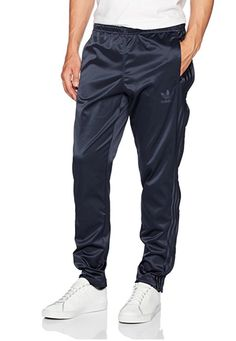 adidas Originals Men's Adicolor Button Down Pant: These men's track pants are a lightweight satin version of an essential street style. Cut for a modern, tapered fit, they have buttons along the outside of each leg for a sport-inspired look. Soccer Pants, Training Pants, Adidas Originals Mens, New Man, Look Cool, Fashion Pictures, Adidas Men, Fashion Brands, Parachute Pants