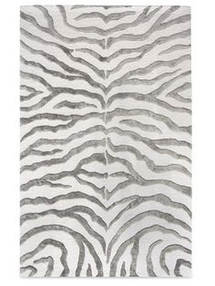 """""""Everyday Glam - Surprising in silver: Rugs USA's wool zebra-print rug ($209, 4' by 6')."""" This would look nice in a gray color scheme decor."""