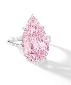 Superb Fancy Vivid Pink Diamond and Diamond Ring; centering on a pear-shaped fancy vivid pink diamond to a stylized mount pavé-set throughout with circular-cut diamonds, mounted in platinum, signed Sotheby's Diamonds. Jewelry Box, Fine Jewelry, Silver Jewelry, Marcasite Jewelry, Jewlery, Jewelry Knots, Macrame Jewelry, Bead Jewelry, Gold Jewellery