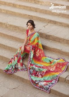 This unique flowery prints on multi colored Georgette saree is a Artistic piece.