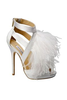 I don't usually like what they come up with for Wedding Shoes, but these are awesome!!!!!!  Jimmy Choo Wedding Shoes