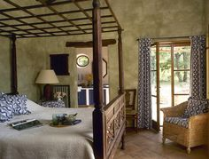 Rustic Bedroom with carved wooden four poster bed ~ <3 lattice top piece. Posted on ZIMBIO. Source: Getty