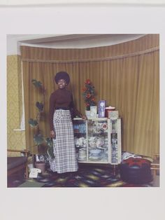 Untitled [Young Jamaican lady standing in her mothers room in Brixton Hill, London, 1973] | Neil Kenlock | VA Search the Collections