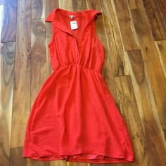 Button down sleeveless dress Button down sleeveless dress, red-orange. Never worn. Perfect condition. Charlotte Russe Dresses