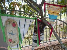 Three prayer flags made by me.  They hand in the backyard in the tree.