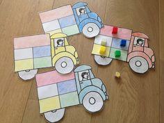 Spel: 4 kleuters. Elke kleuter heeft een vrachtwagen, om de beurt gooien ze met de kleurendobbelsteen, ze nemen de juiste kleur van lading en leggen het in hun vrachtwagen. Wie als eerste zijn vrachtwagen vol heeft is de winnaar.