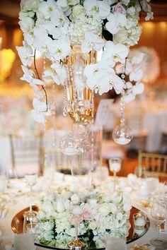 White orchid centerpiece for wedding table decor // Bryan and Carmen's Versailles-Inspired Ballroom Wedding at Ritz-Carlton