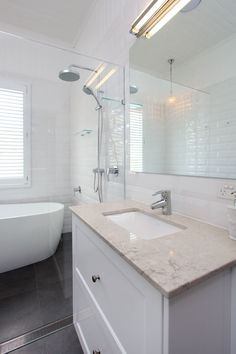 I like the strip drain aligned with shower screen. clean. 6131 Bianco Drift™ - Divine Bathroom Kitchen Laundry