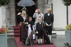 King Harald and Queen Sonja, Crown Prince Haakon of Norway and Crown Princess Mette-Marit of Norway with Princess Ingrid Alexandra, Prince Sverre Magnus and Marius Borg Høiby greet the Childrens Parade on the Skaugum Estate on May 17, 2015 in Oslo, Norway. (17th of May is Norway's National Day and an official national holiday. 201 years ago the constitution was created at Eidsvoll and Norway became an independent kingdom after a 434 years union with Denmark)