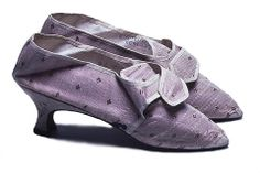 Women's Shoes, 1775.  Pair of pink floral brocade with latchet straps, lined with white linen. Italian or peg top heels. Top bound with cream silk ribbon.