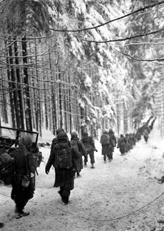 U.S. soldiers of the 289th Infantry Regiment on the march in Belgium. January 24, 1945.   Richard A. Massenge