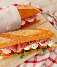 "These ""Caprese Prosciutto Sandwiches"" are a hybrid of a ham sandwich and an Italian salad.  They are perfect for a brown bag lunch or even a picnic!"