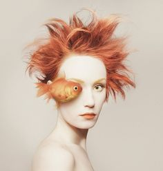 Flora Borsi is a fine art photographer from Hungary, she has titled this self-portrait project 'Animeyed'. Flora has cleverly combined herself with various animals by overlapping the animal's eye over one of hers and changing her look and props to suit the subject.