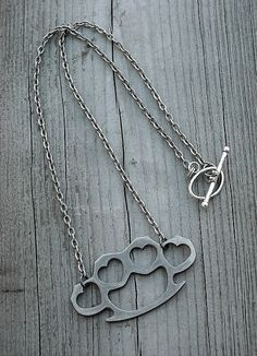 Gunmetal Heart Brass Knuckles Necklace by InkandRoses13