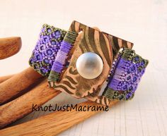 Micro macrame cuff by Sherri Stokey of Knot Just Macrame with leather snap clasp by Melinda Orr.
