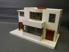 An Art Deco painted wood doll's house, 32'' x