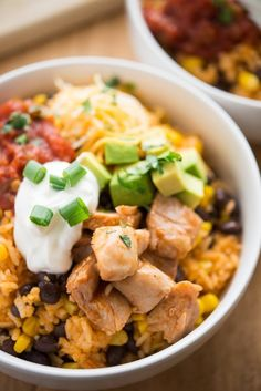 BBQ Chicken Burrito Bowls. This recipe includes chicken breast or thighs, rice, onion, corn, black beans, BBQ sauce, shredded cheese, cilantro, sour cream.