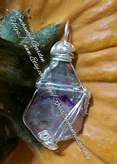 This lovely pendant features Super 7 Crystal wrapped in Sliver Tone wire. Will comes with a black cord necklace that has a adjustable clasp.  Super 7 Crystal. Although not always visible a piece of Super Seven retains all the properties of Amethyst, Clear Quartz. Smoky Quartz, Cacoxenite, Rutile, Geothite and Lepidocrocite combined.