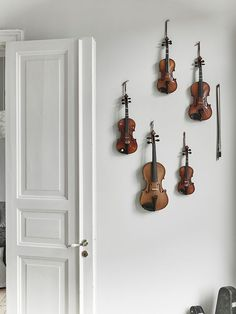 violin collection hung on the wall agentlewoman.com