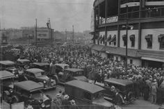 The crowd at Wrigley Field lines up for tickets for the World Series game between the Chicago Cubs and the Detroit Tigers in October 1935. The stadium was built in 1914 and celebrates its centennial this year.