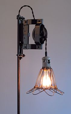 Reclaimed, Repurposed Vintage Industrial Pulley Lamp If you like this then check out my shop for one of a kind handmade art and decor items https://www.etsy.com/shop/SalehDesigns?ref=si_shop industrial chic vintage reclaimed up cycled repurposed game of thrones gears steampunk welded steel sculptures eclectic decor