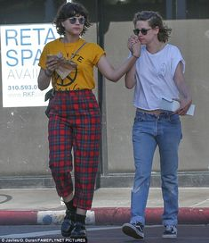 Affectionate: Kristen planted a kiss on her new girlfriend as they held hands...