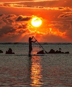 sunset paddle board