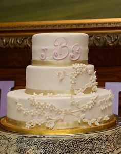 I designed my cake to look like the lace on my dress. The back of the cake had buttons and pleats like the back of my dress. I did our monogram on top instead of a topper or flowers.   Cake done by Lou of Ronnie's Bakery in Bluffton, SC