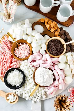 This Hot Chocolate Dessert Charcuterie Board is just beautiful and sure to be a hit at your next party! Piled high with soft marshmallows and loaded with yummy hot chocolate toppings, everyone will have a great time making their own hot chocolate creations. Charcuterie Boards are a huge trend right now! After making my Harvest Charcuterie Board, I couldn't stop thinking of more fun ideas for the holidays. #holidays #dessert #dessertfoodrecipe
