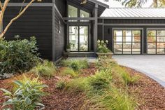A new exterior painted black with updated driveway and landscaping creates a bold front yard that sets the tone for HGTV Dream Home a moody modern escape with a coastal twist. Hgtv Dream Homes, Low Maintenance Landscaping, Front Yard Landscaping, Landscaping Ideas, Front Walkway, Landscaping Software, Exterior Remodel, Waterfront Homes, Waterfront Cottage