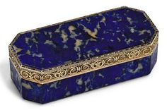 AN AUSTRIAN GOLD-MOUNTED LAPIS LAZULI SNUFF-BOX  BY JOSEF WOLFFGANG SCHMIDT (FL. 1770-1813), MARKED, VIENNA, 1803  octagonal box of lapis lazuli, the hinged cover with gold mounts chased and engraved with flowers and trailing foliage on a sablé ground  3¾ in. (95 mm.) wide