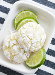 Sweet and just a bit tart with a heavenly coconut smell while baking, these Coconut Key Lime Crinkle Cookies are just the right sized dessert bite for all your warmer weather grilling and Mexican meals. Lime Cookie Recipes, Lime Recipes, Sweet Recipes, Baking Recipes, Dessert Recipes, Bar Recipes, Baking Ideas, Dessert Ideas, Yummy Recipes