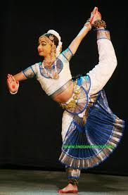 Arts: In the image above you see a young girl performing a traditional Indian dance. The different styles of dance differ, depending on where you live. The dances themselves tell stories of Gods and poems. They use lots of hand and arm movements, the dancer's facial movements and eyes indicate the mood of the dance piece.
