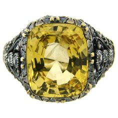 1950s Mario Buccellati Yellow Sapphire Diamond Gold Ring.  Features a 10 carat cushion cut yellow sapphire tastefully set in white gold and yellow gold setting and accented with cushion and rose cut diamonds. Amazing meticulous filigree on gold! Gorgeous and wearable ring!    The ring has a Mario Buccellati maker's mark on the shank.
