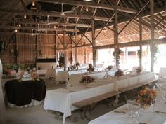 generally i don't dig on picnic tables, but for a rustic reception with burlap runners this could be perfect!